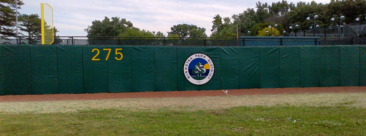 mandatory backstop wall padding for softball stadiums are you ready